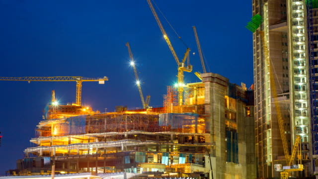 4k time lapse tilt down: big construction site at day and night series - construction vehicle stock videos & royalty-free footage