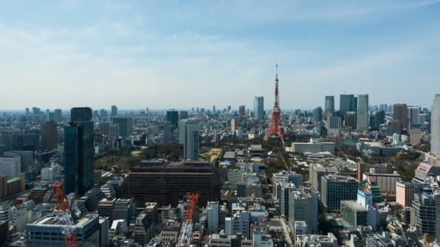4K Time lapse: Time lapse of Tokyo city skyline with Tokyo Tower, Zoom in shot