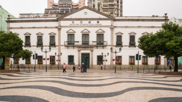 4k time lapse : timelapse view of the historical district of macau, a former portugese colonial city - leal senado square stock videos and b-roll footage