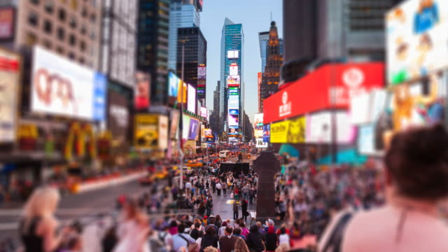 Time Lapse, ZO of Times Square at dusk, selective focus