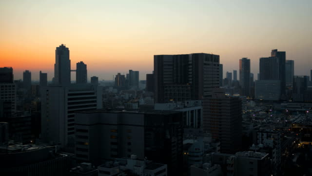 time lapse tokyo metropolis sunrise cityscape structures japan - 場所点の映像素材/bロール