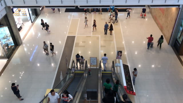 time lapse top view indoor popular shopping mall with escalator and people at bangkok,thailand - store opening stock videos & royalty-free footage