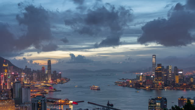 4k time lapse top view scene of hong kong cityscape skyscraper at day to night time - victoria harbour hong kong stock videos & royalty-free footage