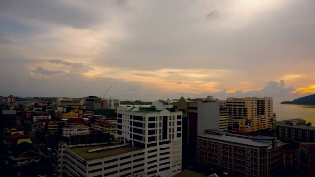 Time lapse top view sunset kota kinabalu town
