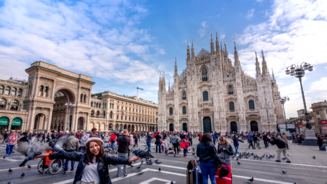 4k time lapse : tourist crowd traveling at milan piazza del duomo, italy - cathedral stock videos & royalty-free footage