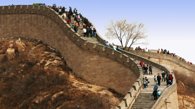 time lapse tourists climbing and descending the stairs of the great wall at badaling / china - badaling great wall stock videos & royalty-free footage