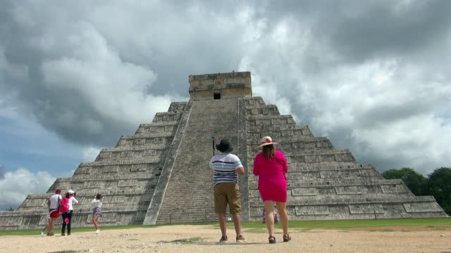 time lapse: tourists enjoying the pyramid of kukulkan - the castle stock videos and b-roll footage