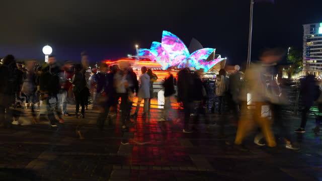 time lapse: tourists near illuminated sydney opera house - fast motion stock videos & royalty-free footage