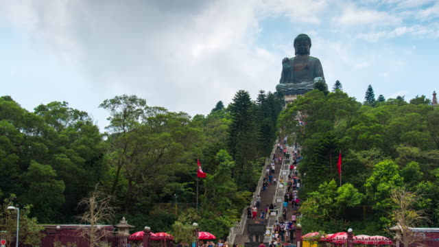 time lapse : tourists visit tian tan buddha at ngong ping, hongkong - tian tan buddha stock videos and b-roll footage