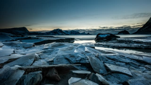 time lapse tracking shot - cracked ice floes at arctic coast of the lofoten islands in norway - mountain peak stock videos & royalty-free footage