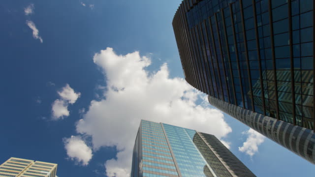 Time Lapse tracking shot of office buildings in La Defense - Paris