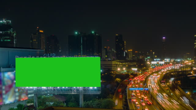 time lapse, traffic and aerial view night cityscape with traffic turnpike highway at downtown bangkok. - billboard stock videos & royalty-free footage