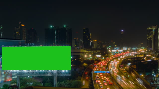 time lapse, traffic and aerial view night cityscape with traffic turnpike highway at downtown bangkok. - tabellone video stock e b–roll