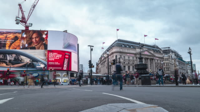 time lapse traffic and pedestrians in piccadilly circus with taxis cars double decker buses and colorful electronic signage - crossing stock videos & royalty-free footage