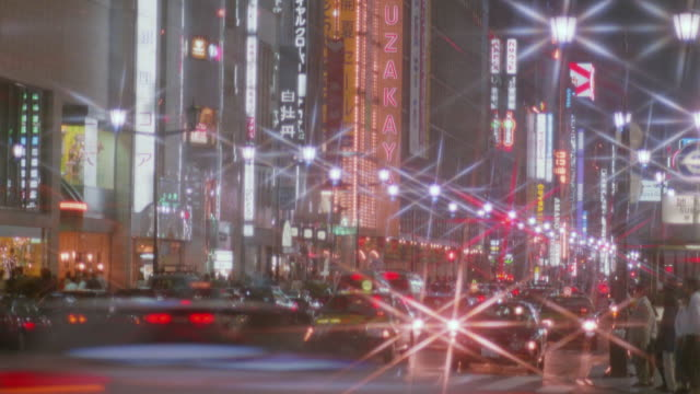 time lapse traffic and people at night / ginza, tokyo / starburst filter - ginza stock videos & royalty-free footage