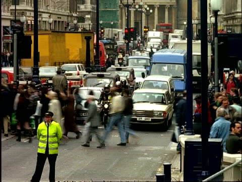 ms archival time lapse traffic and people walking, regent street, oxford circus, london, uk - british culture stock videos & royalty-free footage
