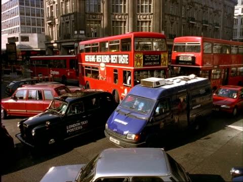 ARCHIVAL Time lapse - CU traffic at crossroads, London