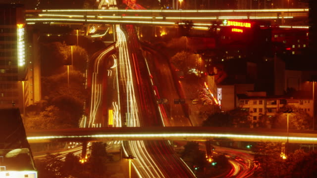 time lapse traffic at night on city freeway in guangzhou - spoonfilm stock-videos und b-roll-filmmaterial