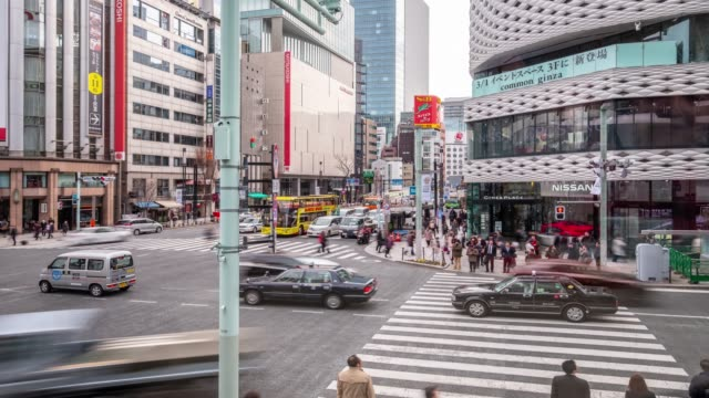 4k time lapse - traffic car transportation at intersection with pedestrian crossing the street - ginza tokyo japan - ginza stock videos & royalty-free footage