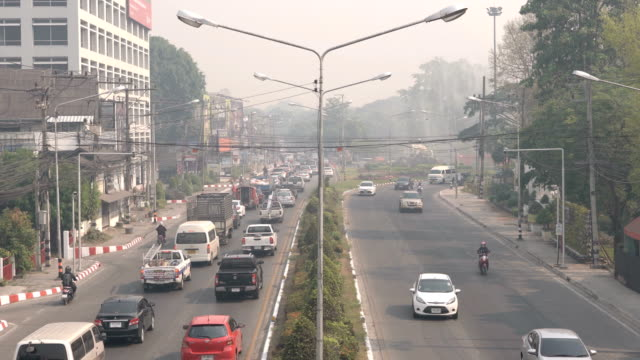 4k time lapse traffic city air pollution in chiang mai, thailand - smog stock videos & royalty-free footage