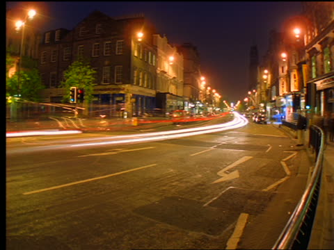 FISHEYE time lapse traffic driving on Princes Street in West End at night / Edinburgh, Scotland