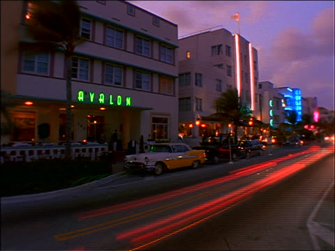 time lapse traffic dusk to night past art deco buildings / Miami
