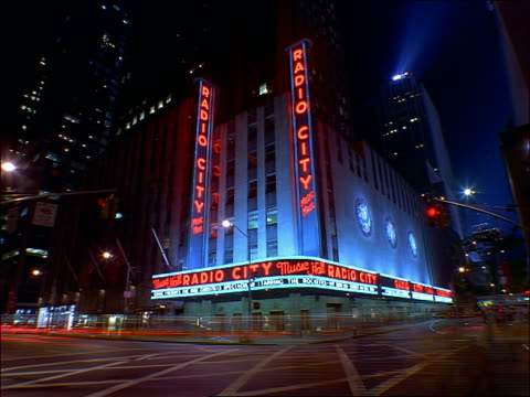 time lapse traffic in front of radio city music hall at night / nyc - radio city music hall stock videos & royalty-free footage