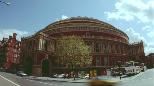 time lapse traffic in front of royal albert hall / clouds in background / london, england - royal albert hall stock videos and b-roll footage