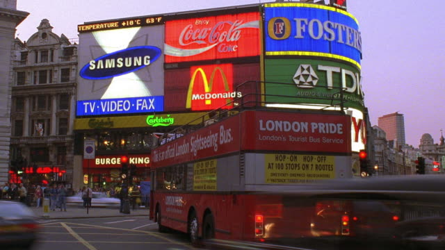 time lapse traffic in piccadilly circus with double decker buses and neon signs in background - mcdonald's stock videos and b-roll footage