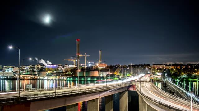 hd time lapse: traffic on bridge at night - strandnära bildbanksvideor och videomaterial från bakom kulisserna