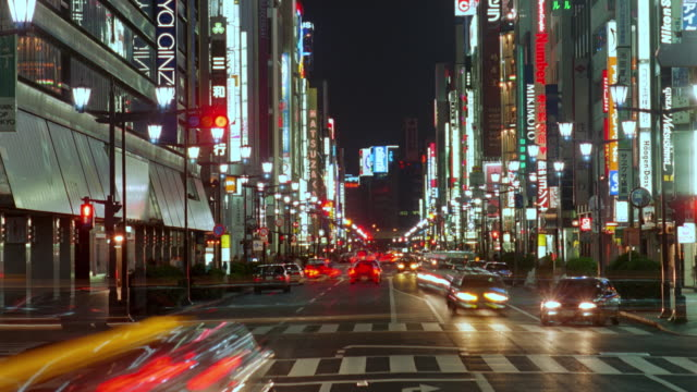 time lapse traffic on busy Ginza street at night / neon signs / Tokyo