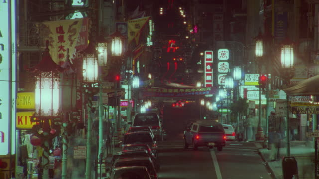 time lapse traffic on chinatown street at night / san francisco, ca - chinatown stock videos and b-roll footage