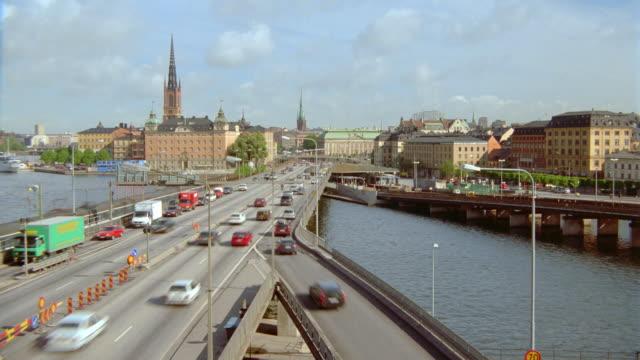 time lapse traffic on highway / pan to train bridge, riddarholmen + gamle stan / stockholm, sweden - scandinavia stock videos & royalty-free footage