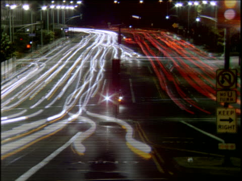 time lapse traffic on wide city street at night