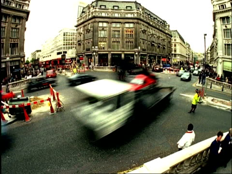 ms archival time lapse traffic, people, roadworks at oxford circus, london, uk - oxford circus stock videos and b-roll footage
