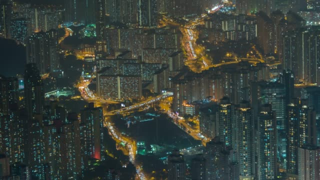 4k time lapse : traffic through modern building at night hong kong city - creativity stock videos & royalty-free footage