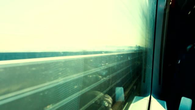 time lapse train moving - treno ad alta velocità video stock e b–roll