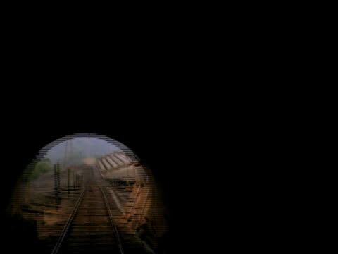 time lapse train point of view on tracks thru tunnel down steep hill - zugperspektive stock-videos und b-roll-filmmaterial