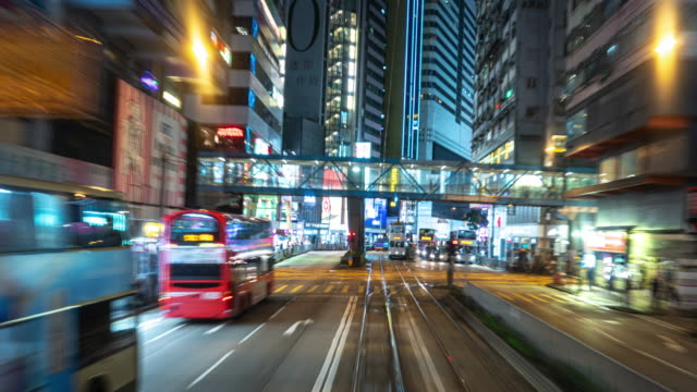 time lapse tram fast speed motion in hong kong city. - bus billboard stock videos & royalty-free footage