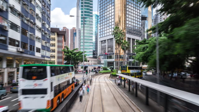 time lapse - tram speeding through hong kong - wanchai stock videos and b-roll footage