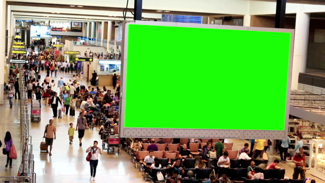 HD Time lapse: Traveler Crowd at Airport with green screen