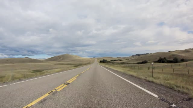 time lapse travelling along fairly empty highway - prairie stock videos & royalty-free footage