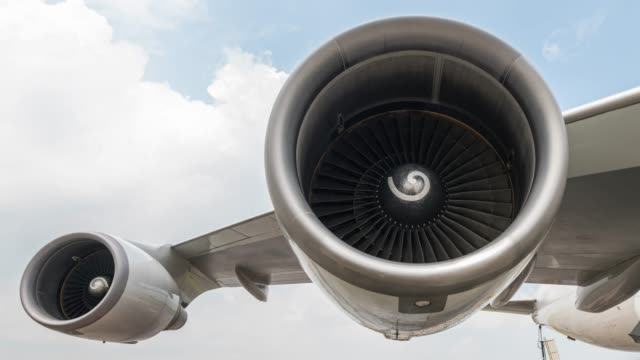 time lapse turbine engine with cloudy sky - zoom out - electric fan stock videos & royalty-free footage