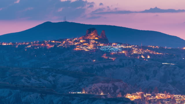 time lapse : twilight panoramic view  ancient cave town and castle of uchisar - cliff dwelling stock videos & royalty-free footage