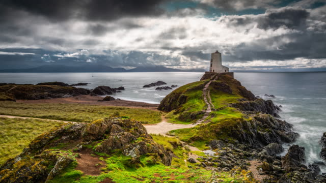 time lapse: twr mawr lighthouse on llanddwyn island, wakes - uk - snowdonia stock videos & royalty-free footage