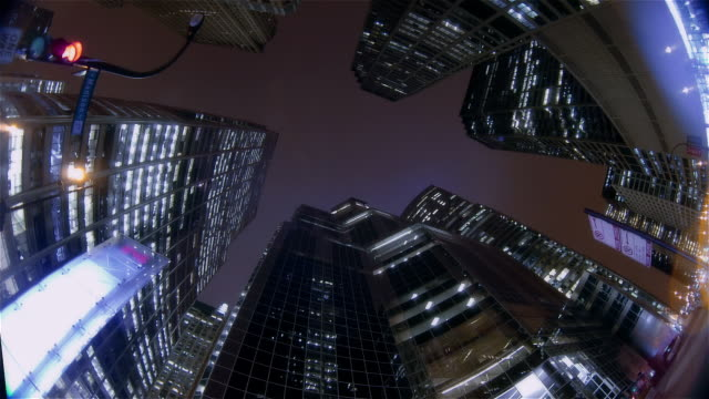 time lapse upward view clouds passing over skyscrapers / night to day / chicago, illinois - low angle view stock videos & royalty-free footage