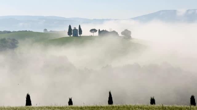 Time lapse valley mist Cappella di Vitaleta chapel Tuscany