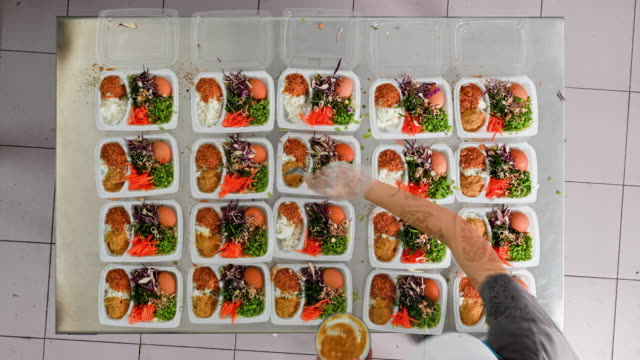time lapse video, asian woman prepare organic vegetable for food meal box for sale on desk in food restaurant shop - preparing food stock videos & royalty-free footage