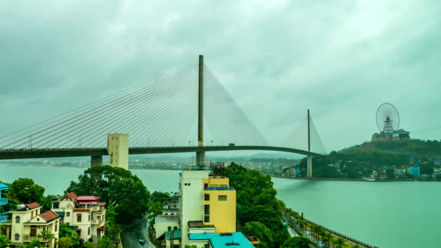 time lapse video : beautiful bai chay bridge at ha long city, vietnam - electricity pylon stock videos & royalty-free footage