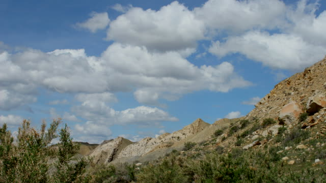 Time lapse video clouds zoom Dinosaur National Monument Utah
